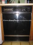 Old black dishwasher
