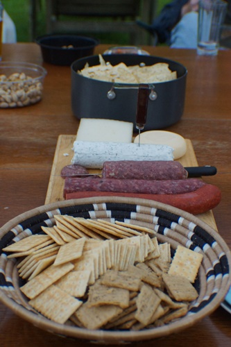 Meat, cheese and crackers on table