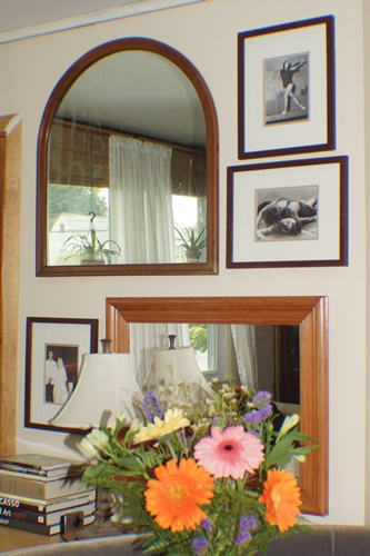 wall with mirrors and pictures